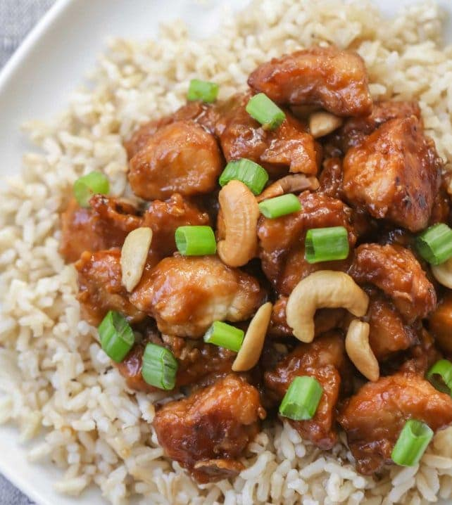 crockpot cashew chicken over rice on plate