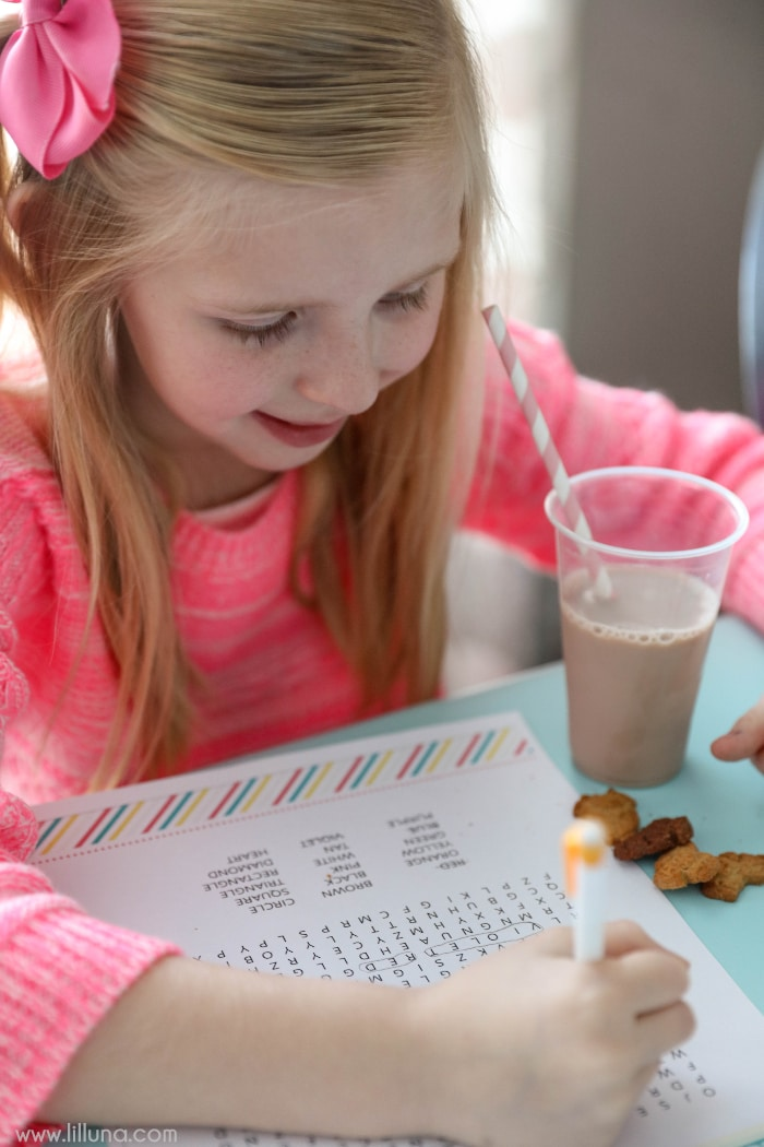 young girl doing word search