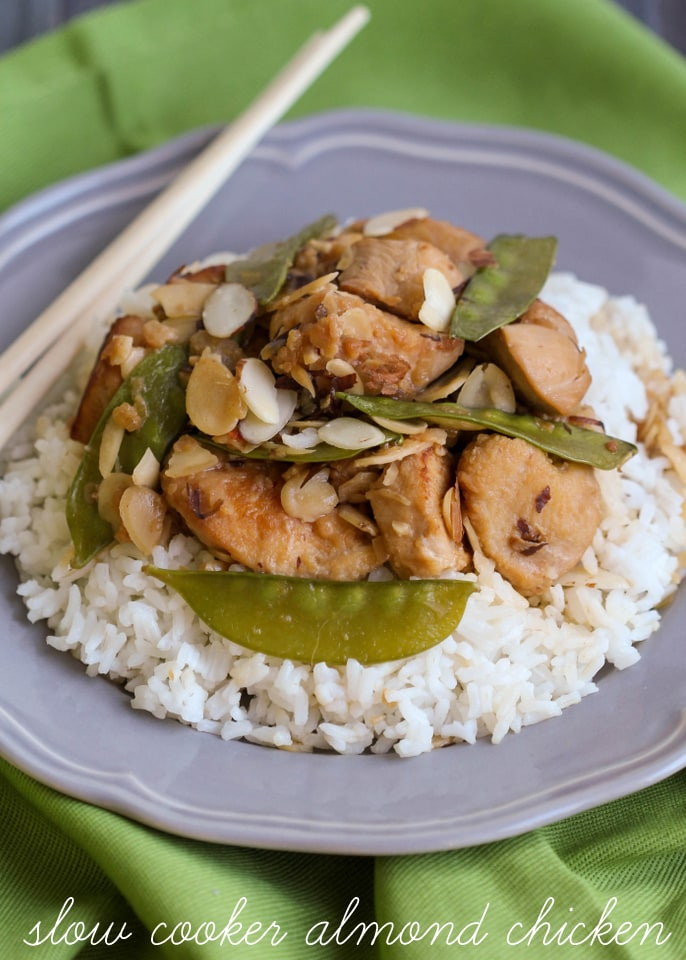 Slow Cooker Almond Chicken - one of the easiest and yummiest dinner recipes you can make in the crock pot! Tasty chicken served with sliced almonds and snow peas and can be served with rice or over noodles.