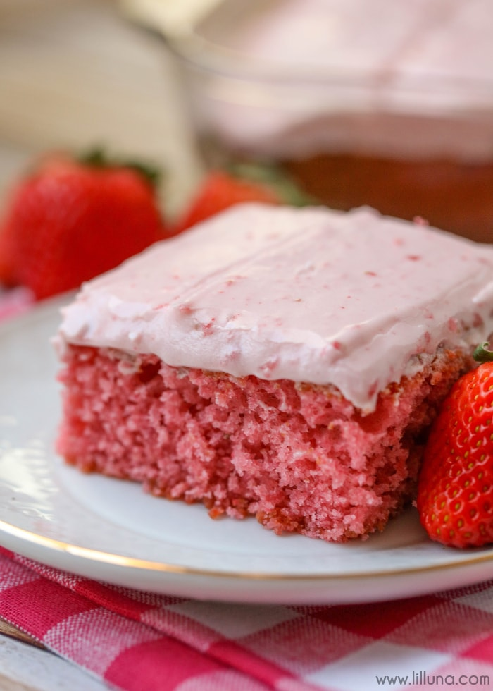 Strawberry Sheet Cake - one of the best desserts ever!! A moist and delicious strawberry cake topped with a strawberry cream cheese frosting!