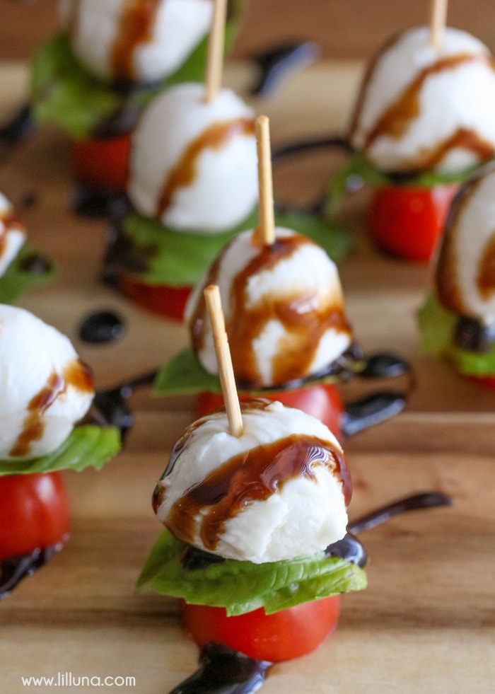 Simple, quick and delicious Caprese Kabobs - grape tomatoes, fresh mozzarella, and basil, drizzled with balsamic vinegar. Takes minutes to throw together and is a great recipe perfect for any party or get together.