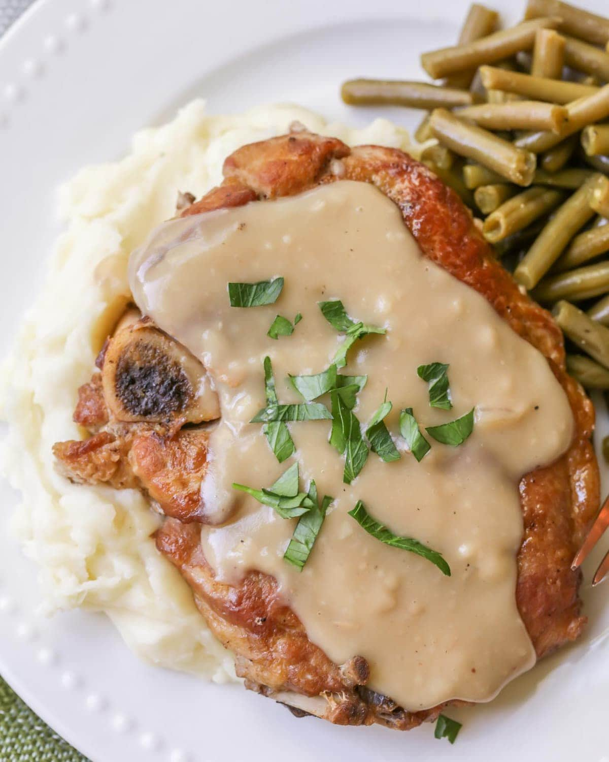 Crock Pot Pork Chops with gravy and parsley