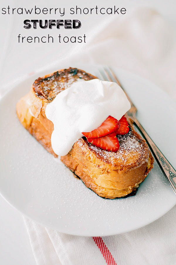 Strawberry Shortcake Stuffed French Toast - this delicious breakfast recipe is stuffed with cream cheese and strawberries and topped with powdered sugar, whipped cream and MORE strawberries!!