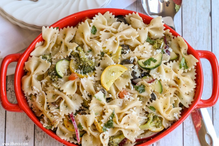 A DELICIOUS and flavorful Veggie Pasta Salad filled with your favorite veggies and topped with a homemade vinaigrette dressing and Parmesan cheese.