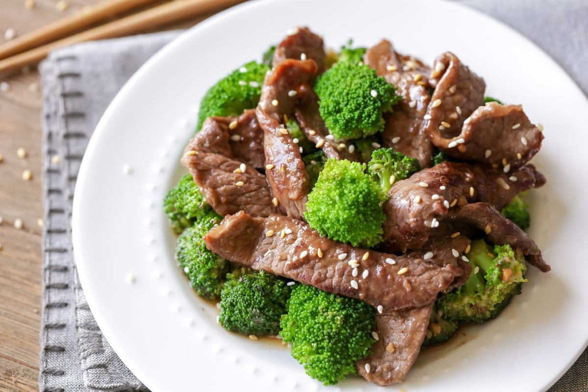 Beef and broccoli stir fry on white plate
