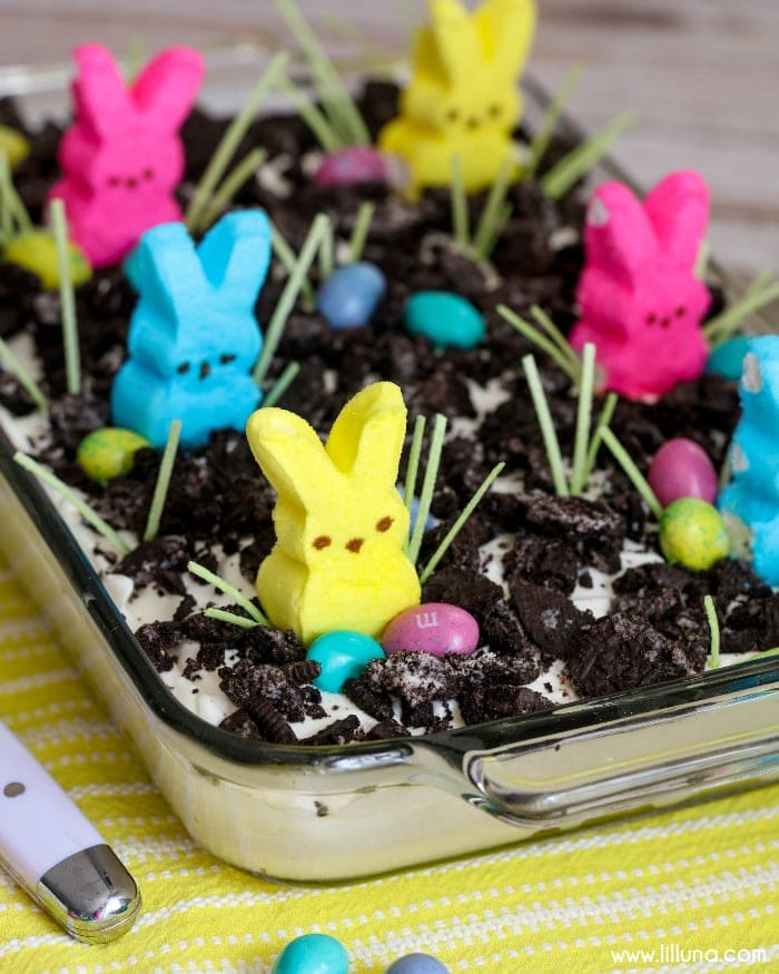 Easter Oreo Dirt Cake - a creamy and delicious Easter dessert filled with oreos, pudding, cool whip, cream cheese, and powdered sugar that everyone will love to decorate and eat!