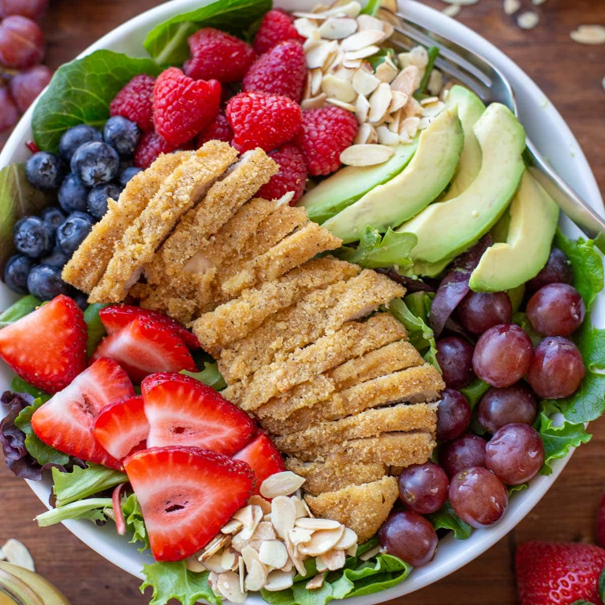 Chicken salad with berries, nuts, and avocado