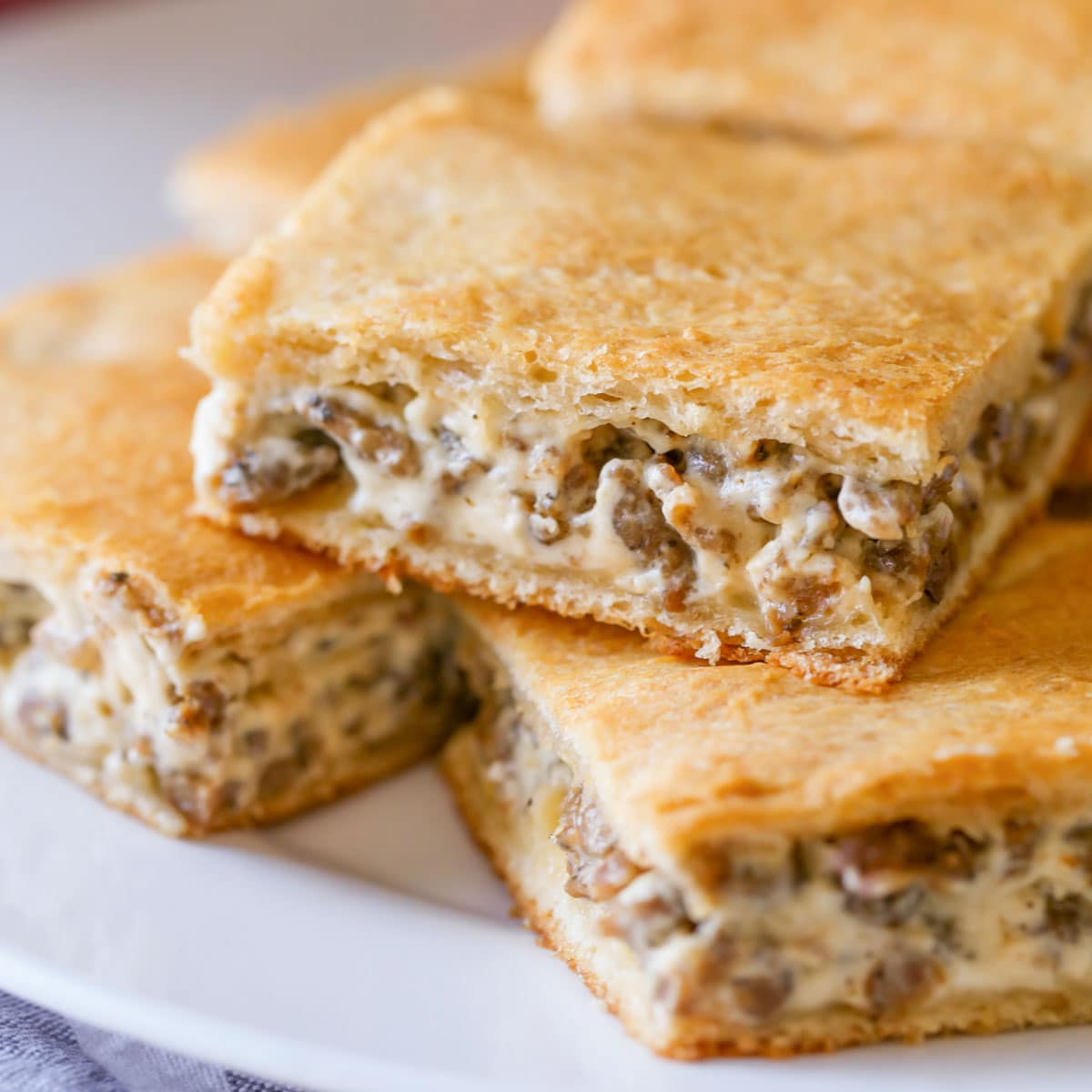 Sausage cream cheese casserole sliced and served on a white platter