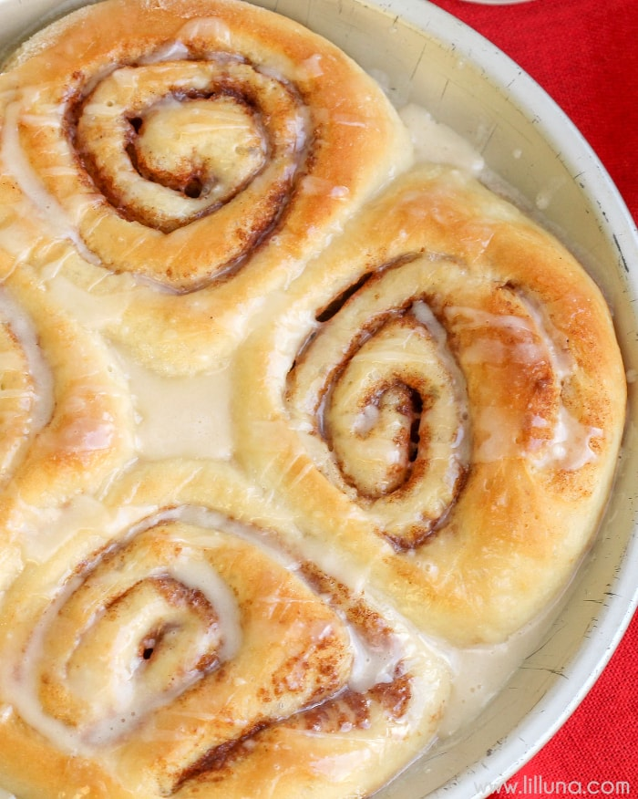 Soft and delicious Spudnut Cinnamon Rolls filled with cinnamon & sugar and mashed potatoes and topped with a delicious glaze. Seriously - so good!