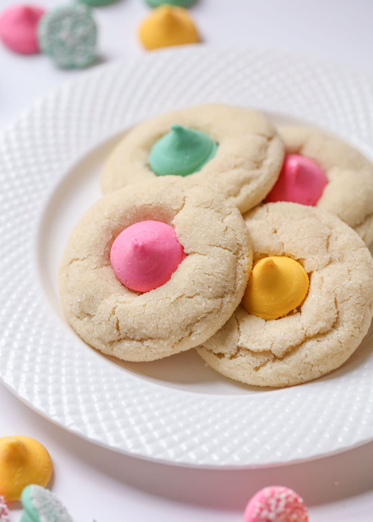 Closeup of sugar cookie blossoms on a white plate
