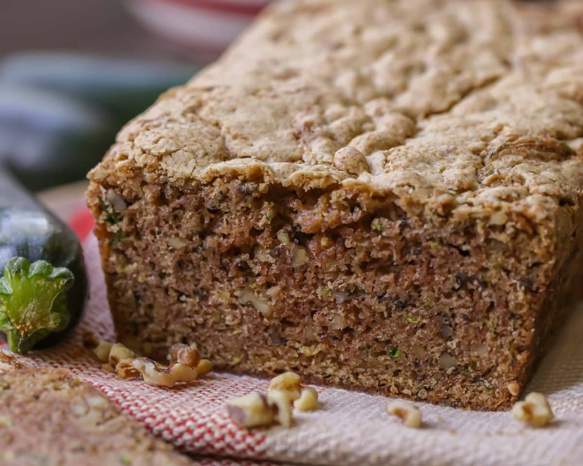 BEST Zucchini Bread filled with nuts on a red napkin