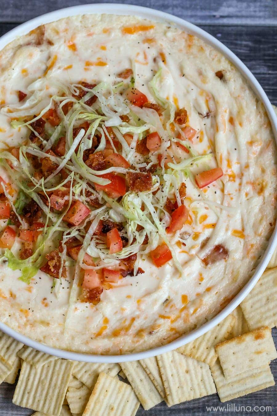 BLT Dip - one of our favorite appetizers! It's loaded with cream cheese, cheese and sour cream and topped with bacon, lettuce and tomato!!