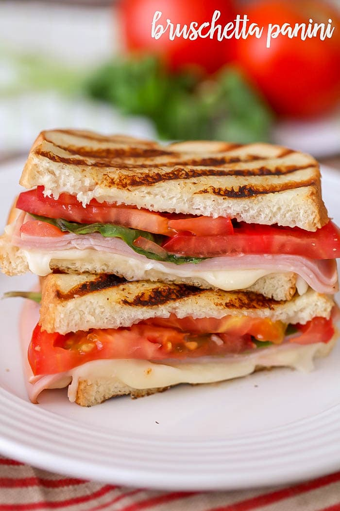 Bruschetta Panini - filled with turkey, mozzarella, basil and tomatoes. It's our new favorite sandwich recipe and is so easy and quick