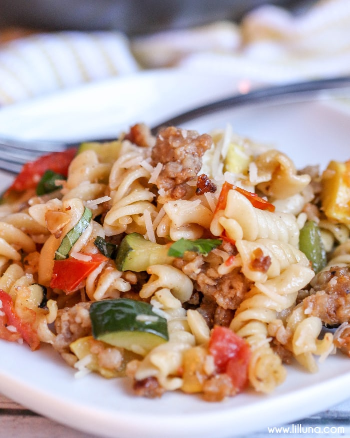 Pasta Primavera - a tried and true dinner recipe! Delicious pasta full of sausage, and vegetables like zucchini, squash, and tomatoes. DELICIOUS!
