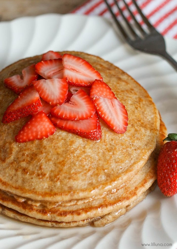 Whole Wheat Blender Pancakes - these pancakes are better than your average flapjacks! Just throw whole wheat, milk, eggs, oil, salt, and baking powder into the blender to whip them up. Easy AND amazingly delicious!!