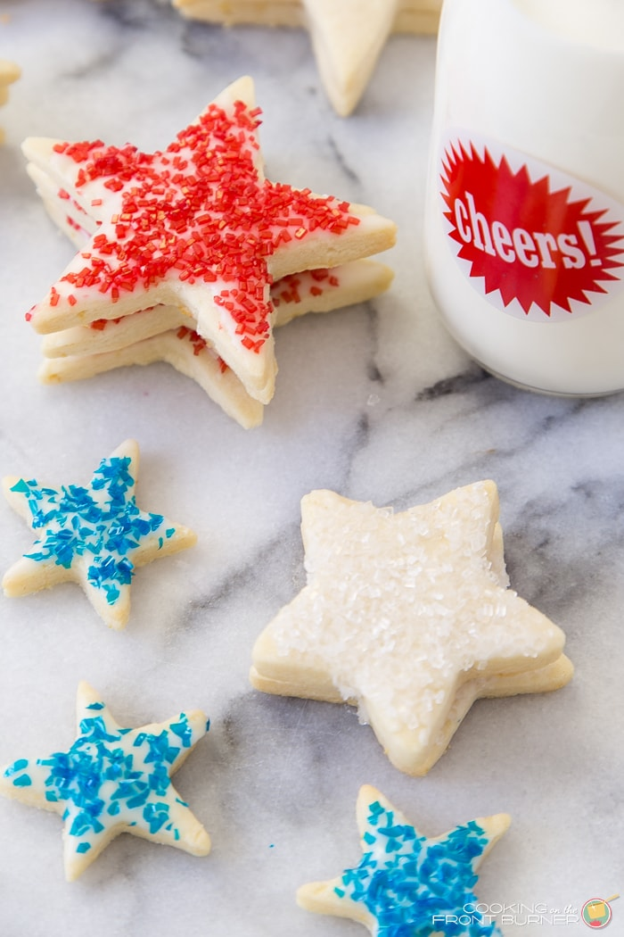 Patriotic Shortbread Cookies - a delicious recipe perfect for the 4th of July! Shortbread cookies topped with homemade frosting and sprinkles! { lilluna.com }