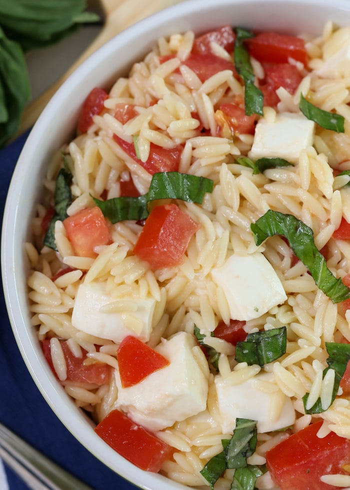 Fresh Mozzarella Pasta Salad - a light and delicious salad filled with orzo, fresh mozzarella cubes, tomatoes and basil. Definitely a new favorite and so simple!