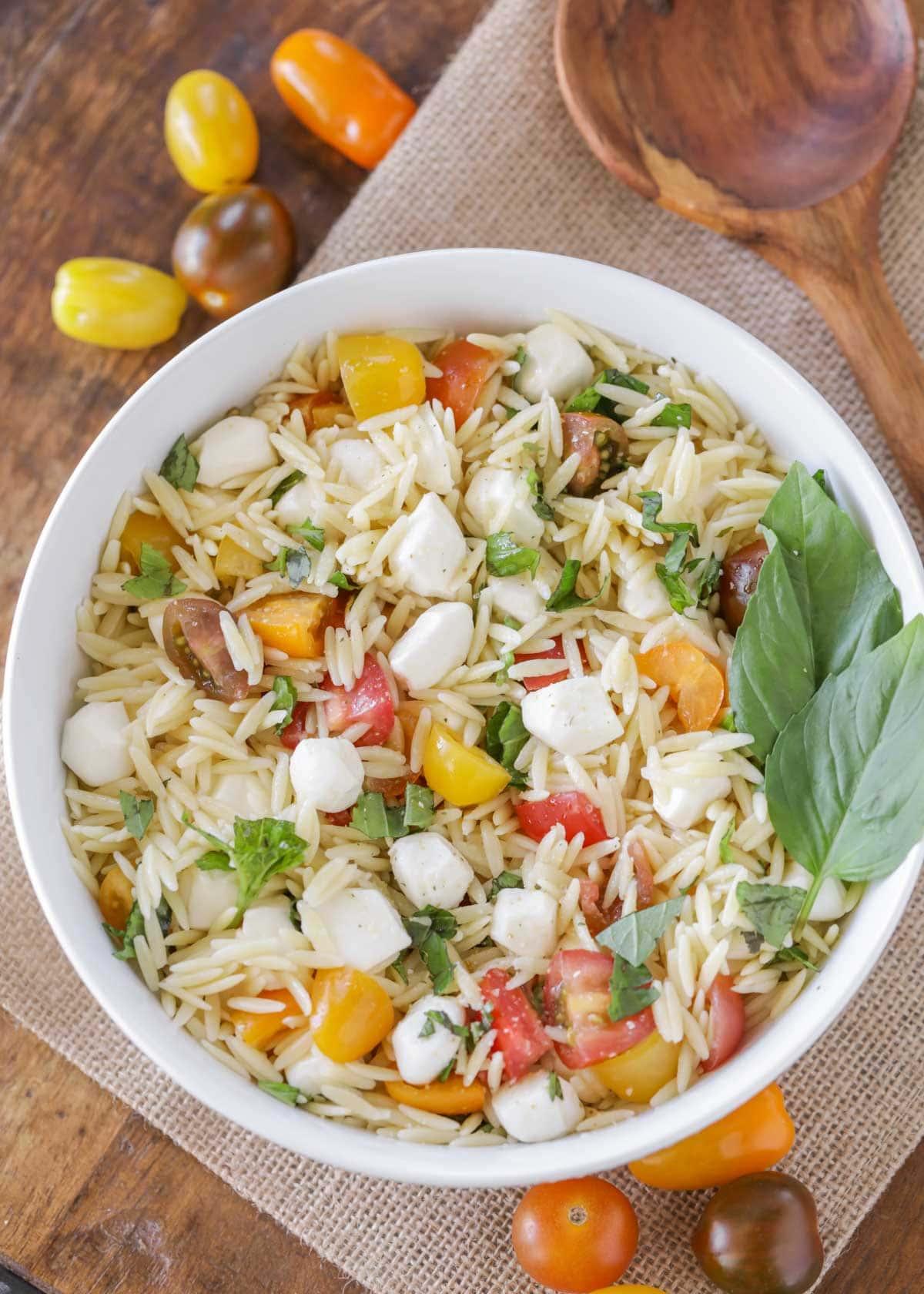 Fresh mozzarella pasta salad in a white bowl