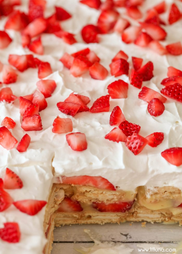 pan of strawberry shortcake lasagna with slice missing