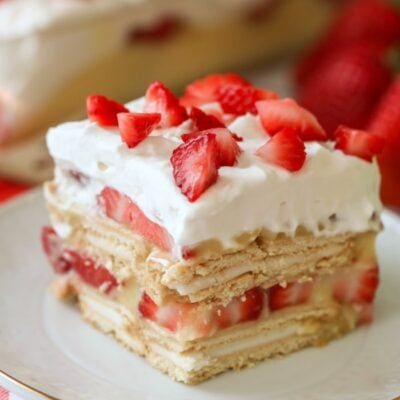 slice of strawberry shortcake lasagna on white plate