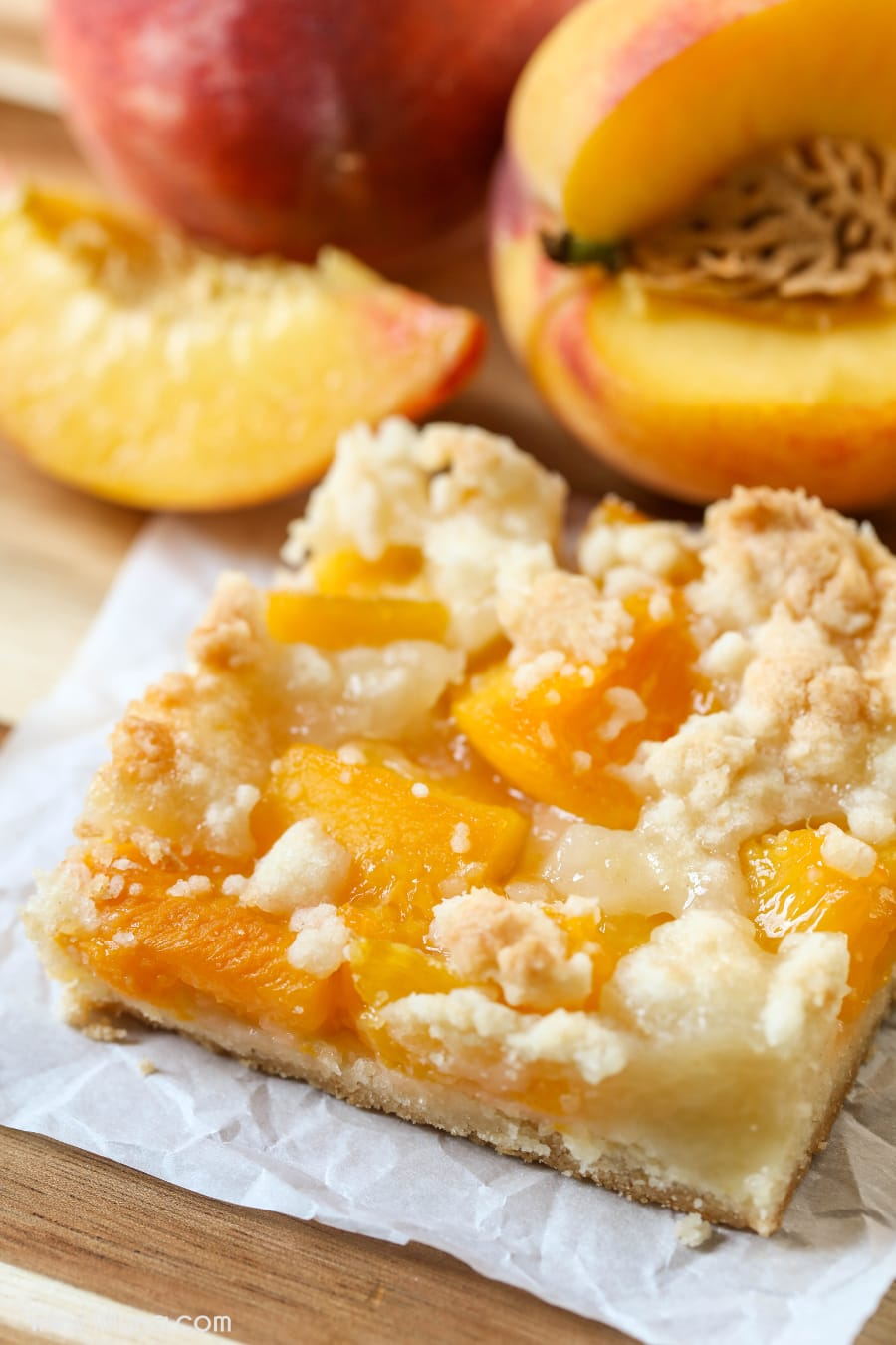 Peach Crumb Bars - a crumbly, soft and delicious bar topped with peaches and batter - perfect for the peach lover in the family!