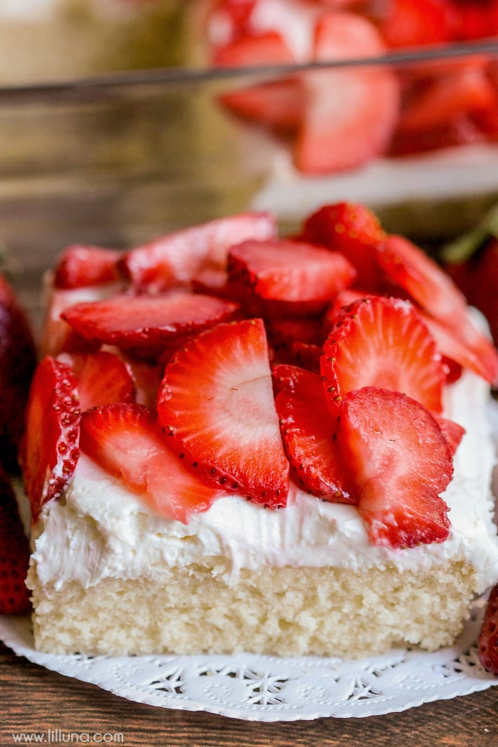 Strawberry Shortcake Bars - super soft cake like crust perfectly combines with a light layer of cream cheese and whipped cream, topped with fresh cold strawberries.