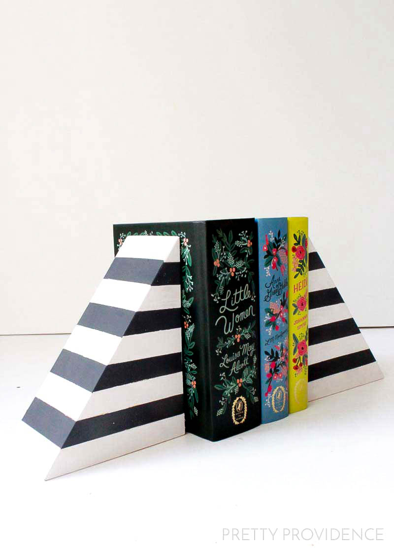 DIY Striped Bookends - West Elm lookalikes but to DIY them costs almost nothing! These cute bookends don't require too much - wood glue, board, wood filler, clamps, and paint!