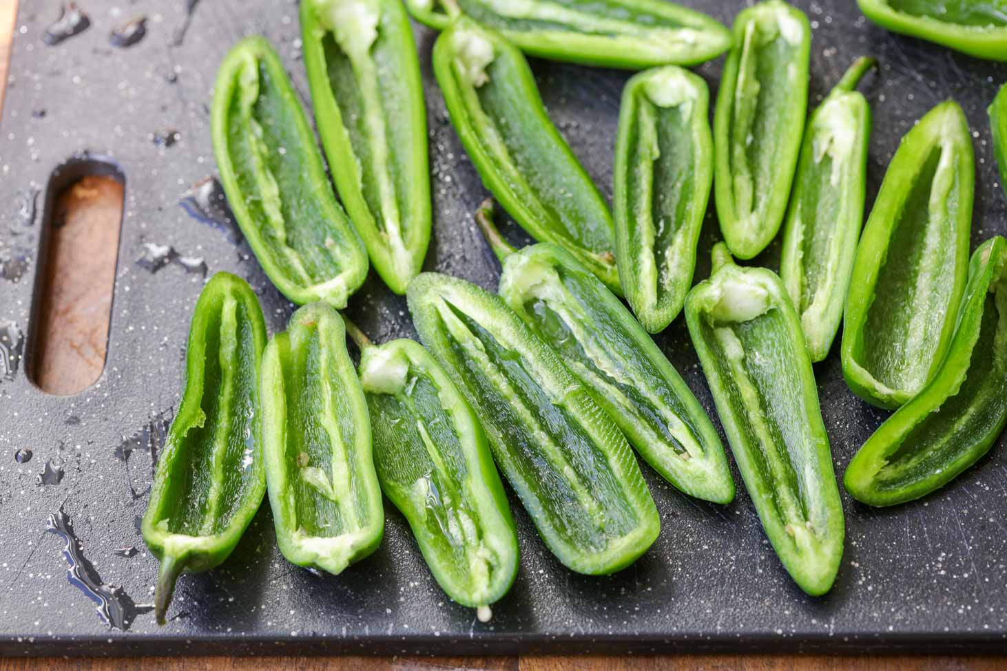 Cut, halved and seeded jalapenos for stuffed jalapenos