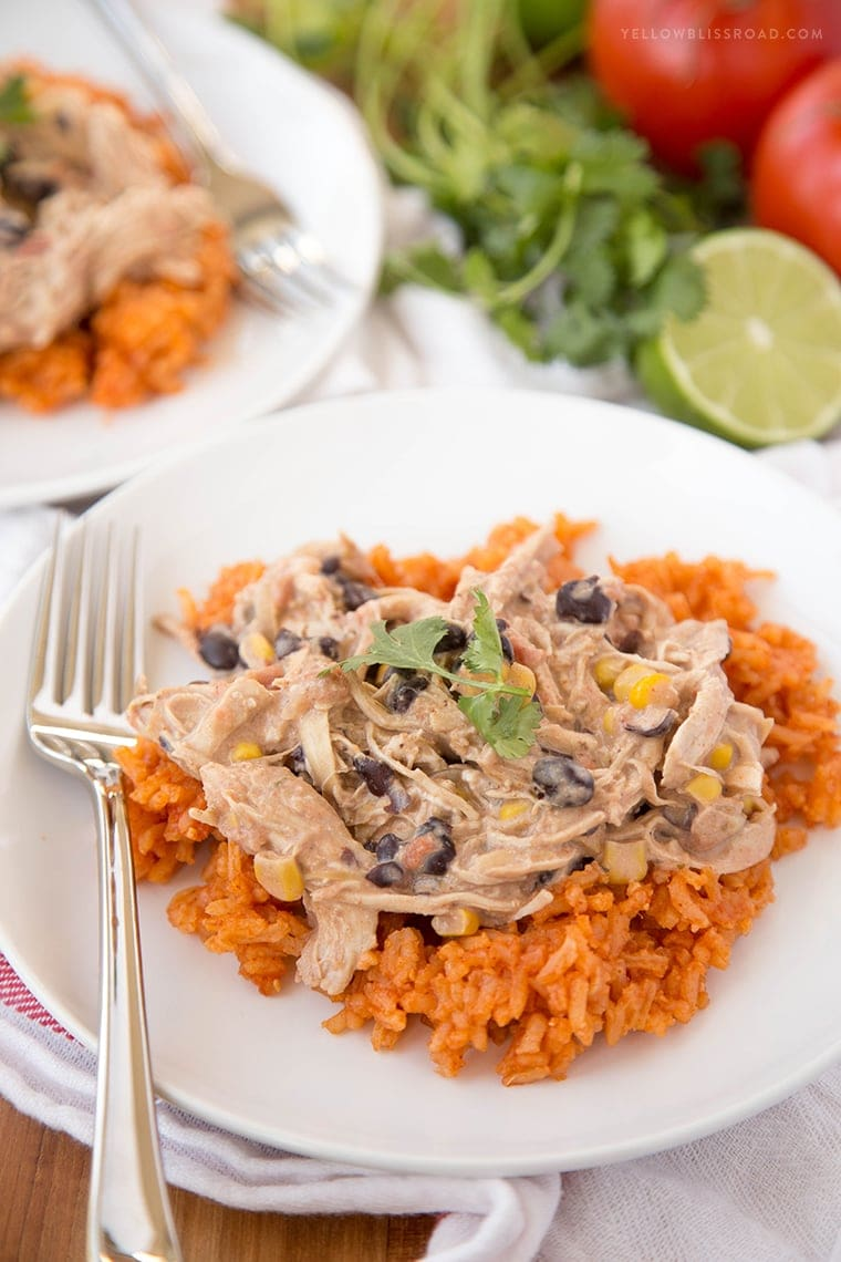 fiesta chicken crockpot meal served over mexican rice