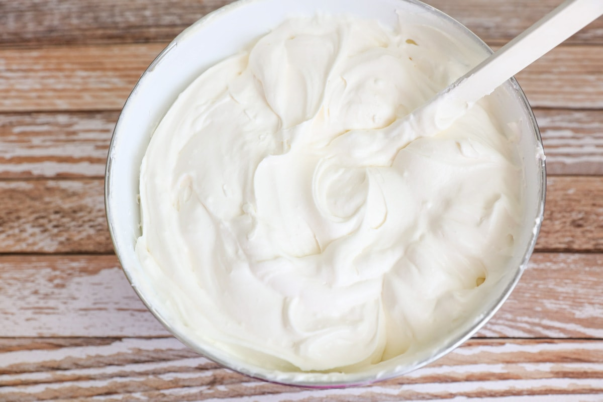 whipped white chocolate pudding in a white bowl