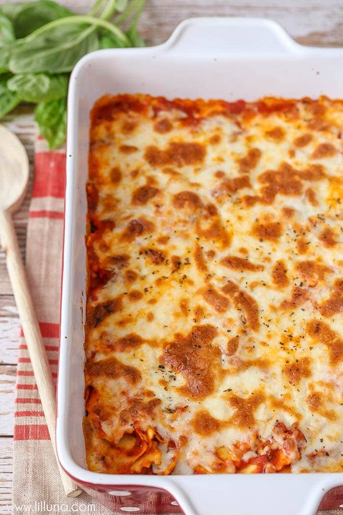 Cheesy Baked Ravioli in casserole dish topped with melted cheese