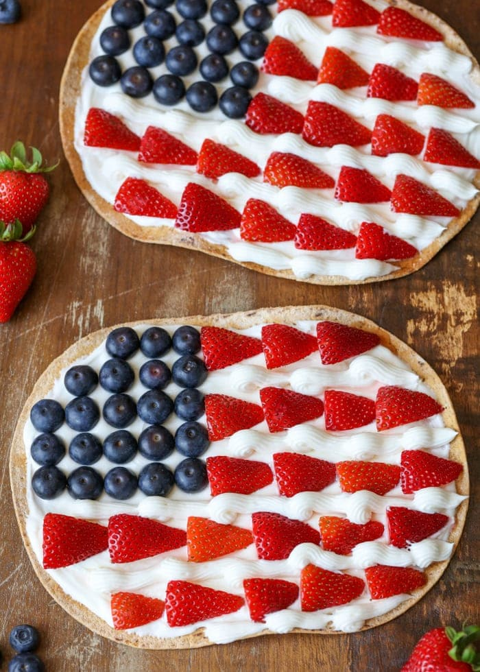 Patriotic Fruit Pizza - a delicious, festive dessert with almond buttercream frosting and topped with fresh blueberries and strawberries!
