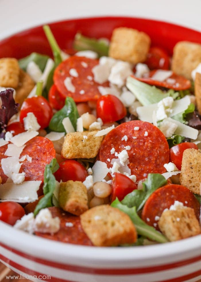 Pizza Salad in red and white bowl