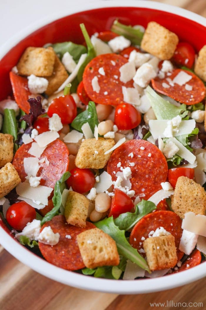Pizza Salad with beans, pepperoni and croutons