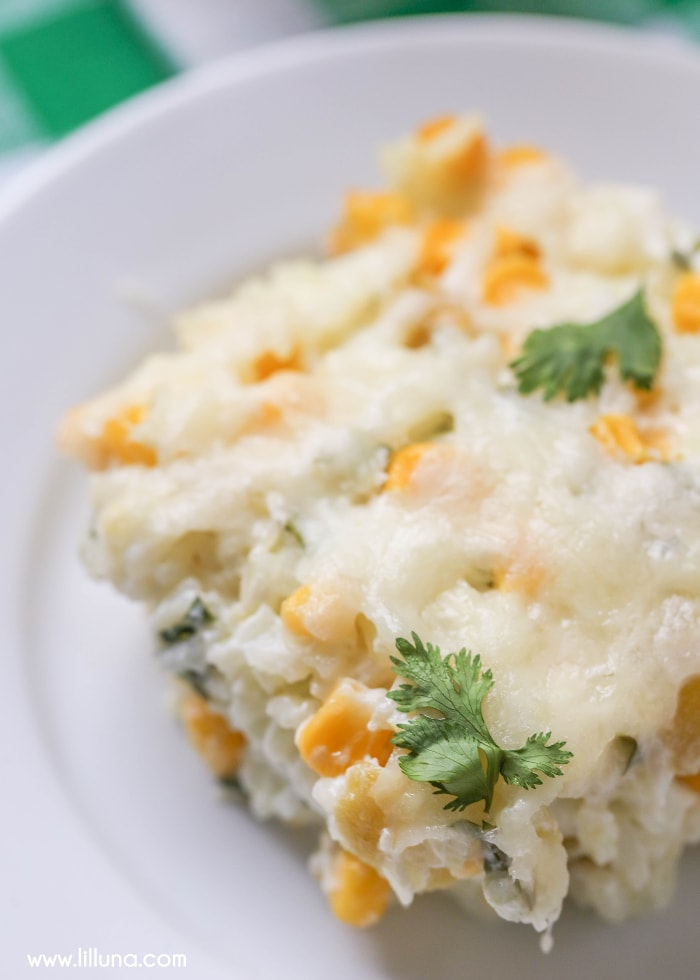 Mexican Sour Cream Rice filled with cheese, corn, green chiles, sour cream and cilantro. This delicious side dish is simple and great with any meal!