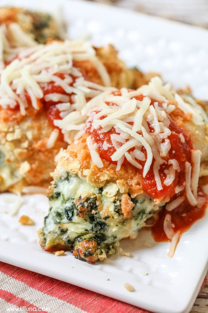 Chicken Parm roll ups on a white platter