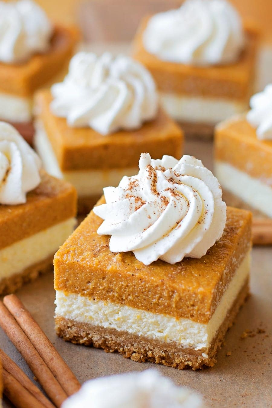 Pumpkin Pie Cheesecake Bars - layers of goodness with a graham cracker crust, cheesecake layer and pumpkin layer. This will be perfect for all fall festivities!