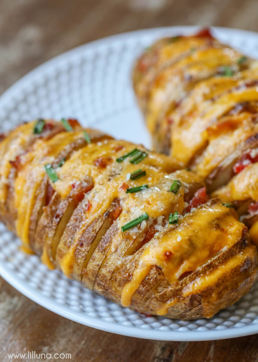 Cheesy Hasselback Potatoes stuffed with cheese, bacon and so much flavor. It's one of the yummiest ways to serve potatoes.