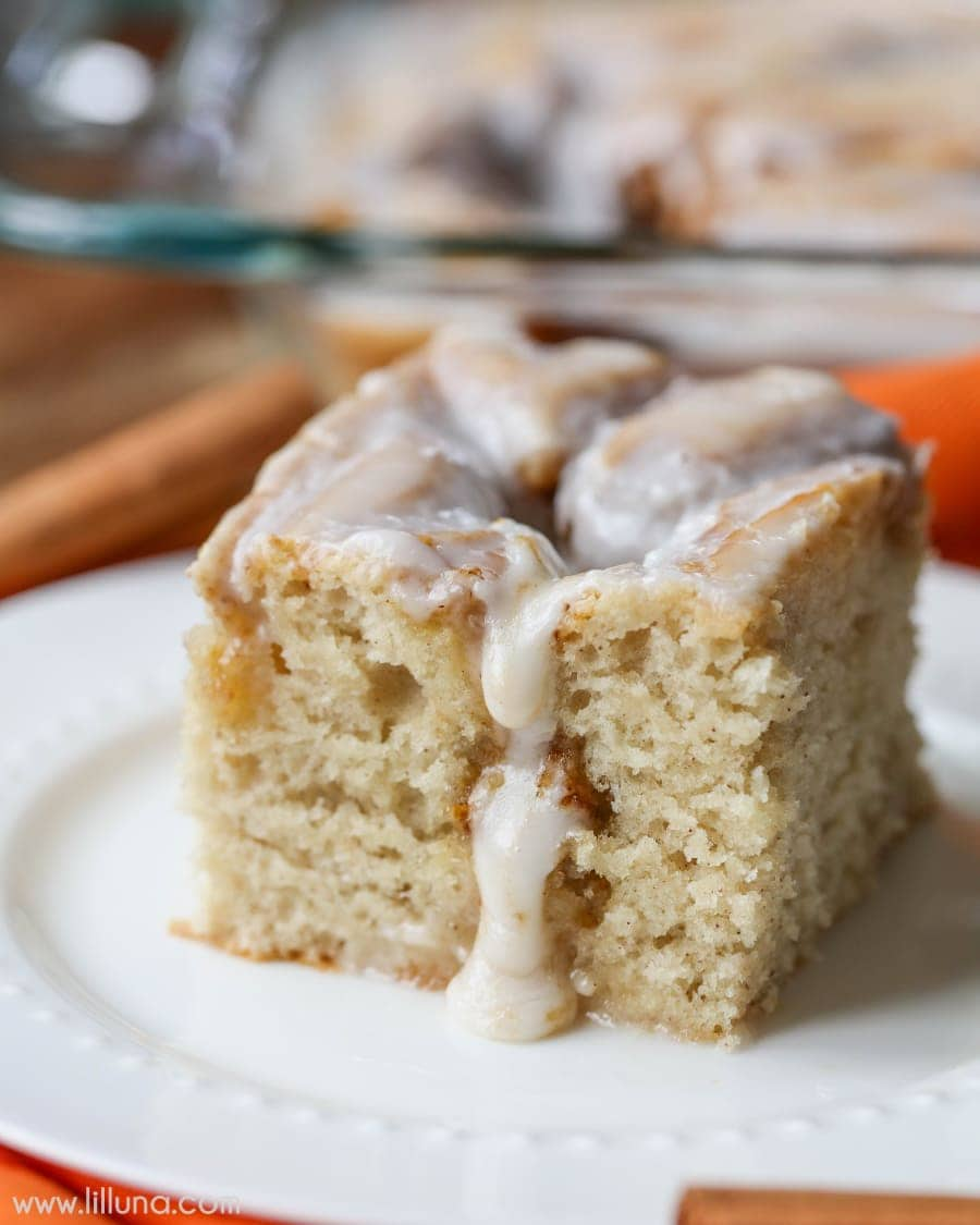 Pumpkin Cinnamon Roll Cake - a delicious, warm frosted cake with flavors of pumpkin, nutmeg and cinnamon! It's our new favorite pumpkin treat!