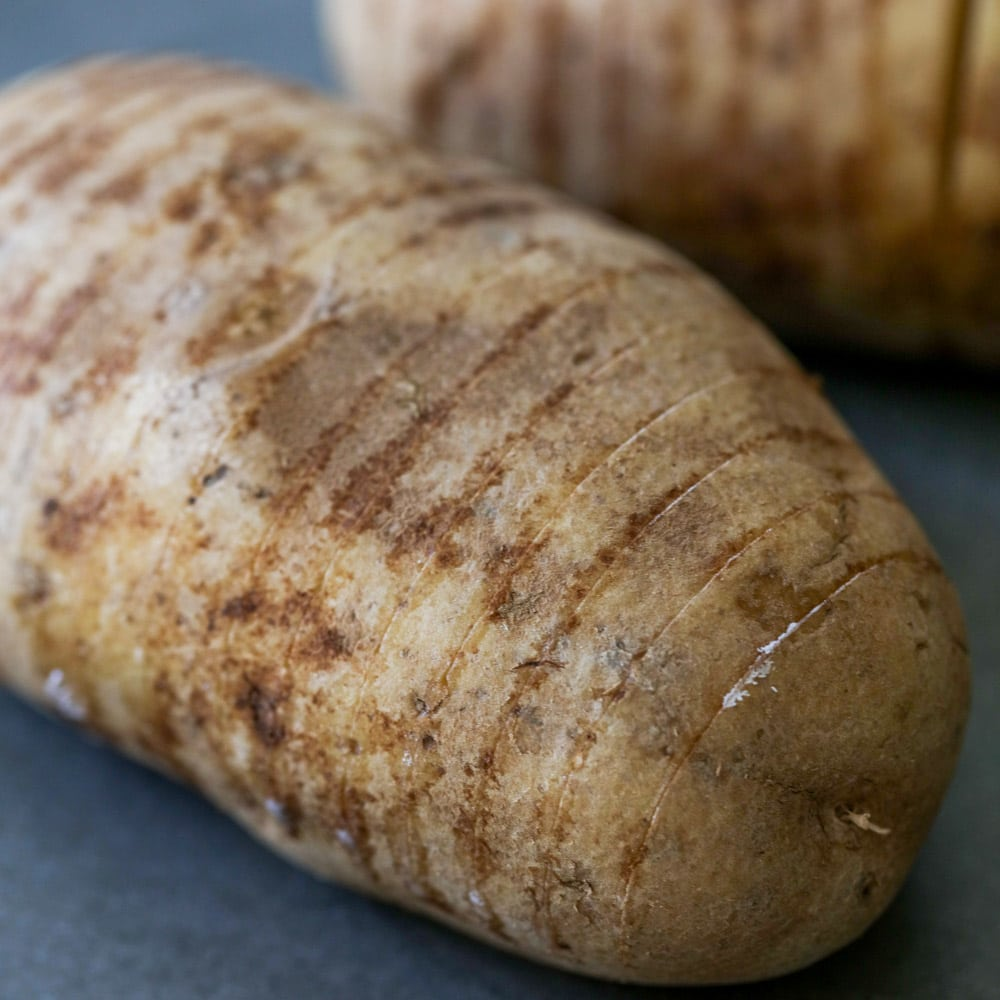 Potatoes cut thinly for hasselback potatoes