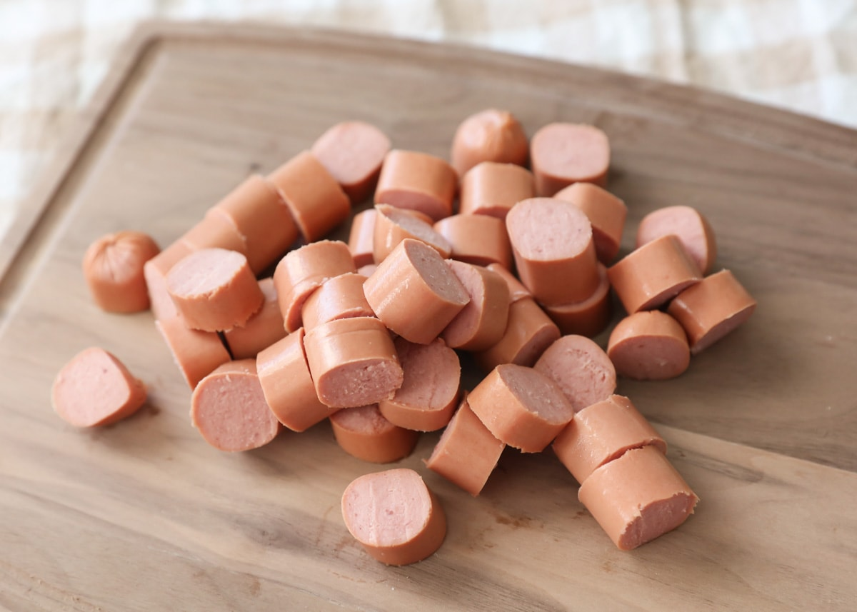 Cut up hot dogs on cutting board