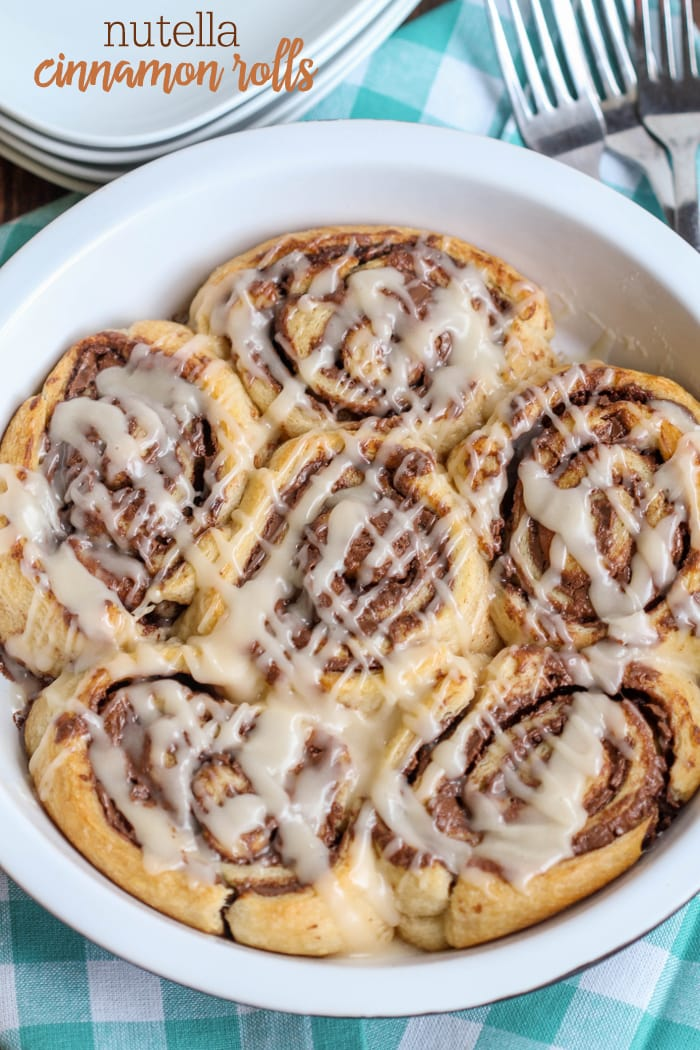 Soft and delicious Nutella Cinnamon Rolls!! These delicious rolls are filled with Nutella and topped with an amazing glaze.