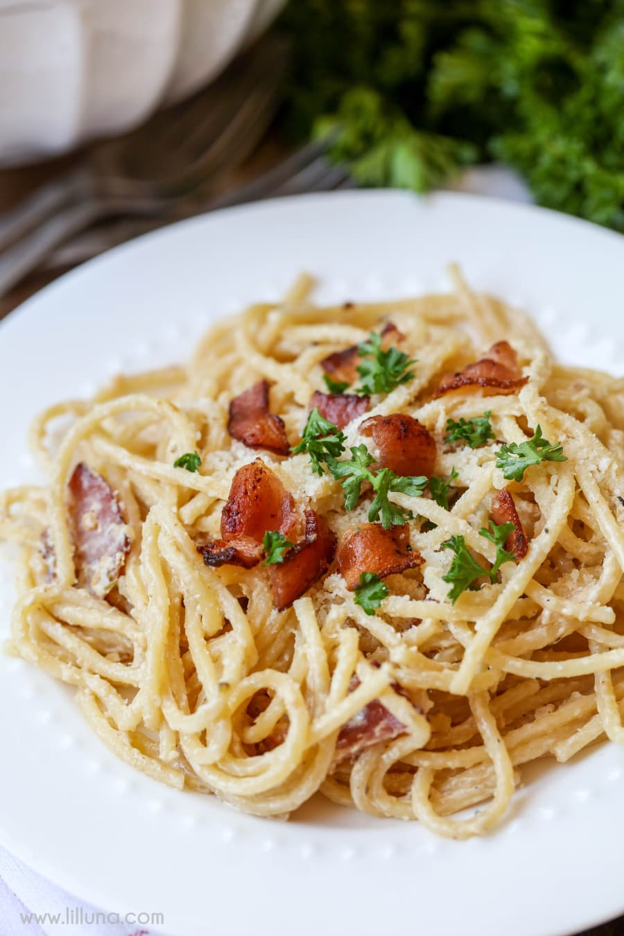 Spaghetti Carbonara - a delicious and flavorful pasta dish that has cream cheese and Parmesan cheese along with bacon and Parsley.