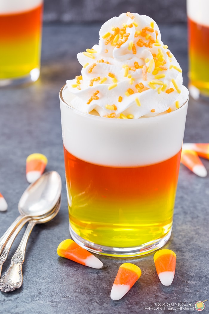 Candy Corn Jello Cups - layers of yummy jello topped with whipped cream and sprinkles !! The perfect Halloween party treat!