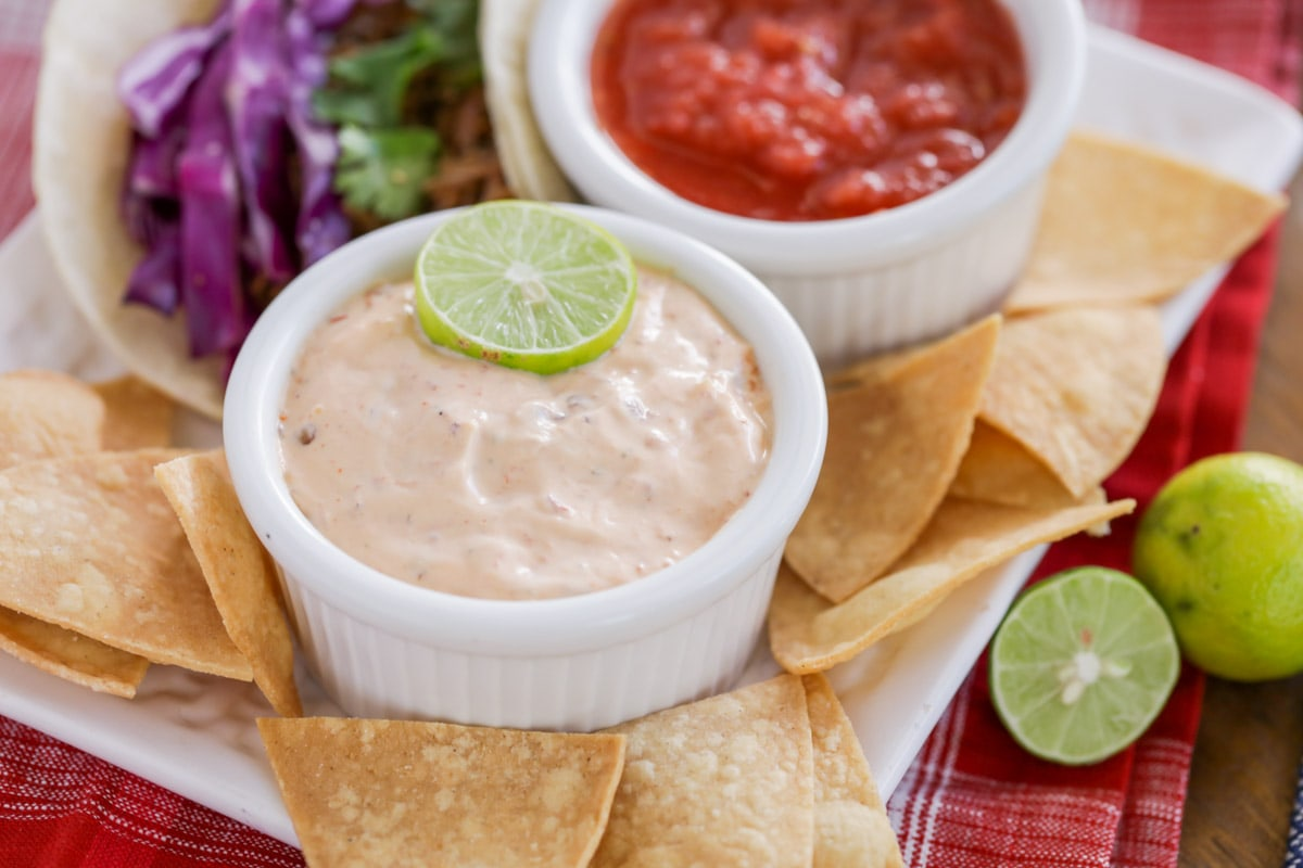 Chipotle ranch dip on a platter with salsa and tortilla chips