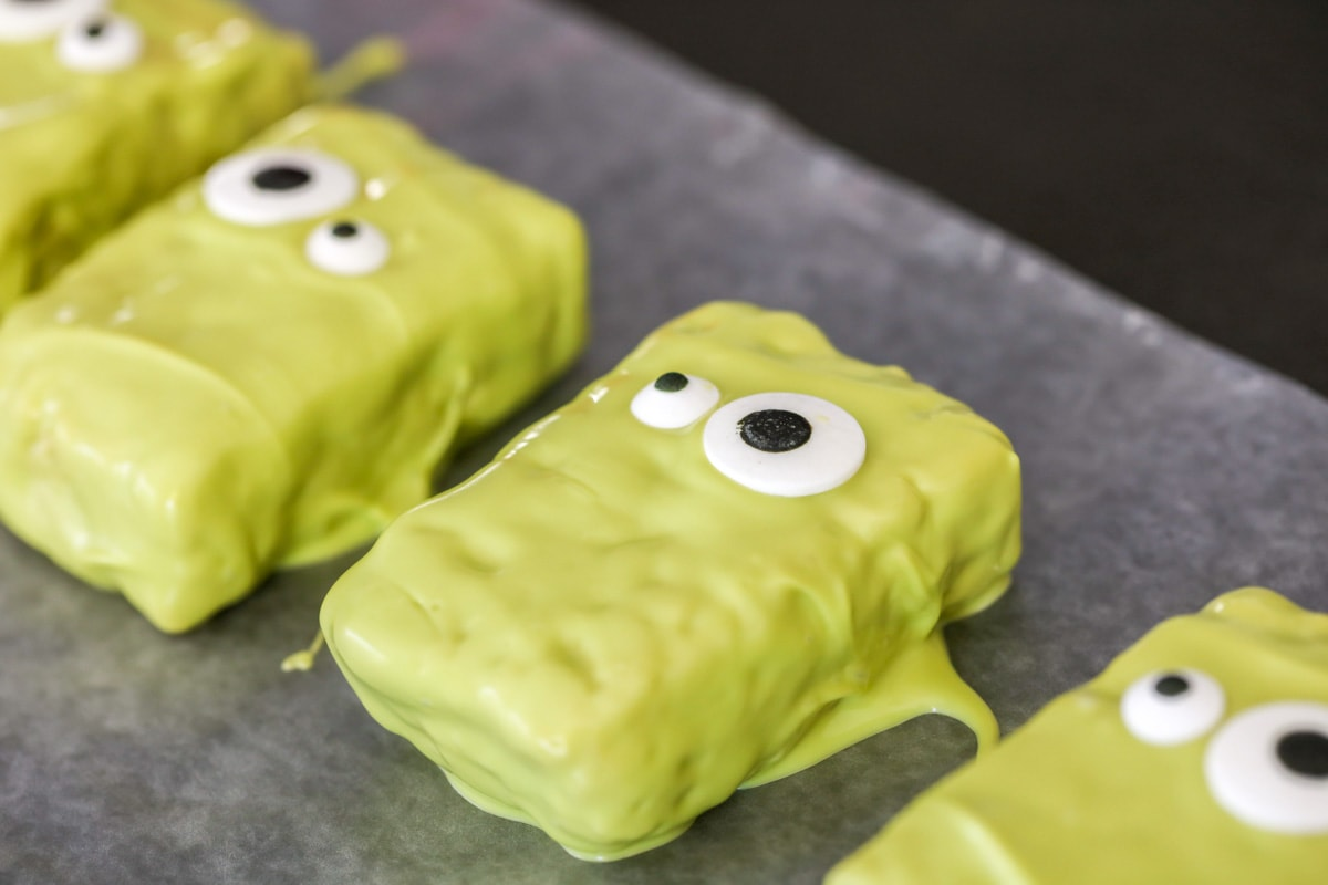 green dipped rice krispie treats with candy eyes