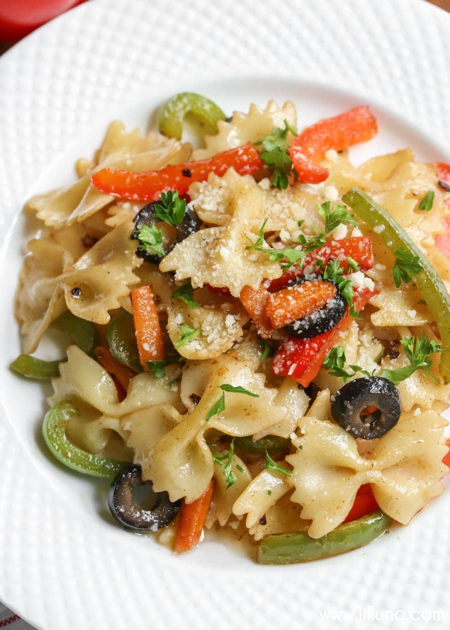 Garlic Butter Pasta - a butter-y pasta dish filled with green and red peppers, carrots, olives, cheese and Parsley. It's so simple and so flavorful!