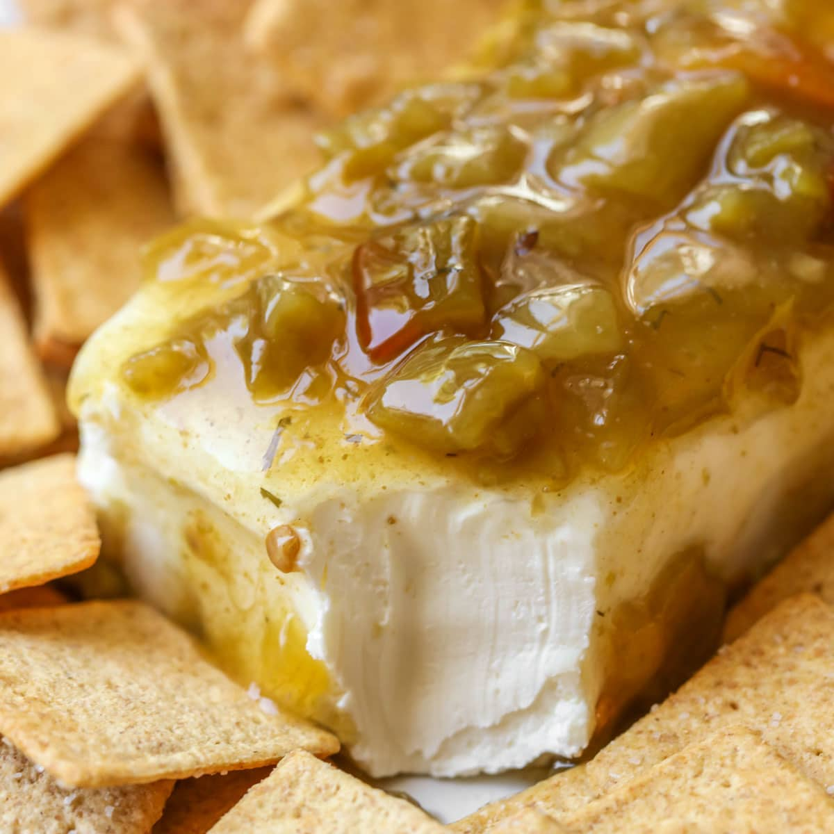 Cream cheese covered in green chili