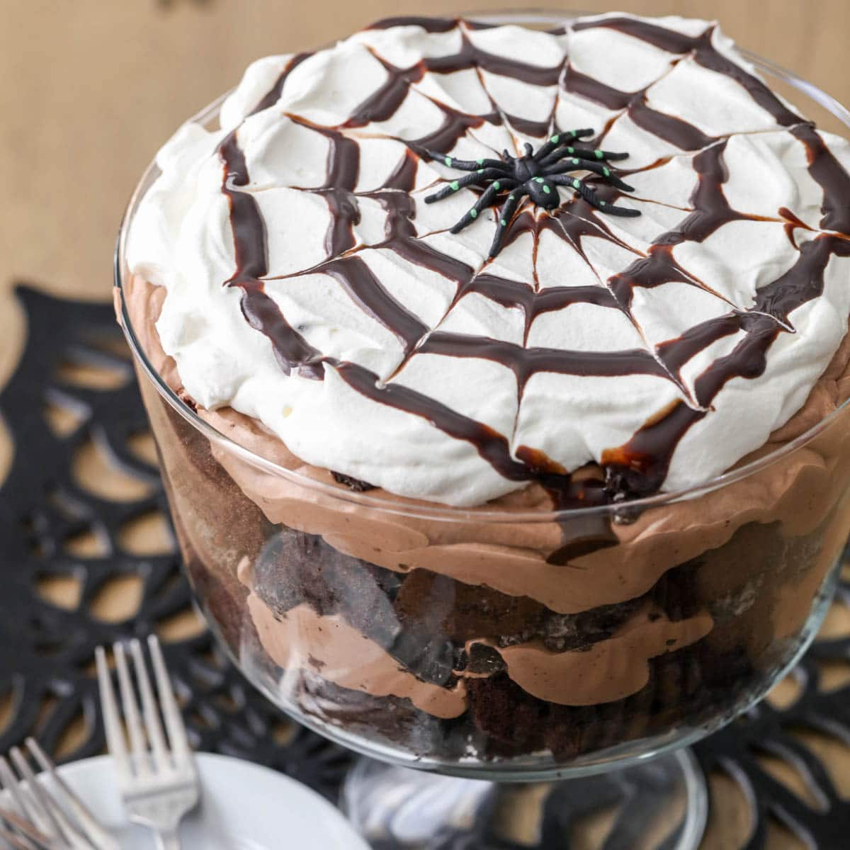 chocolate spider trifle topped with a spider  in a glass dish