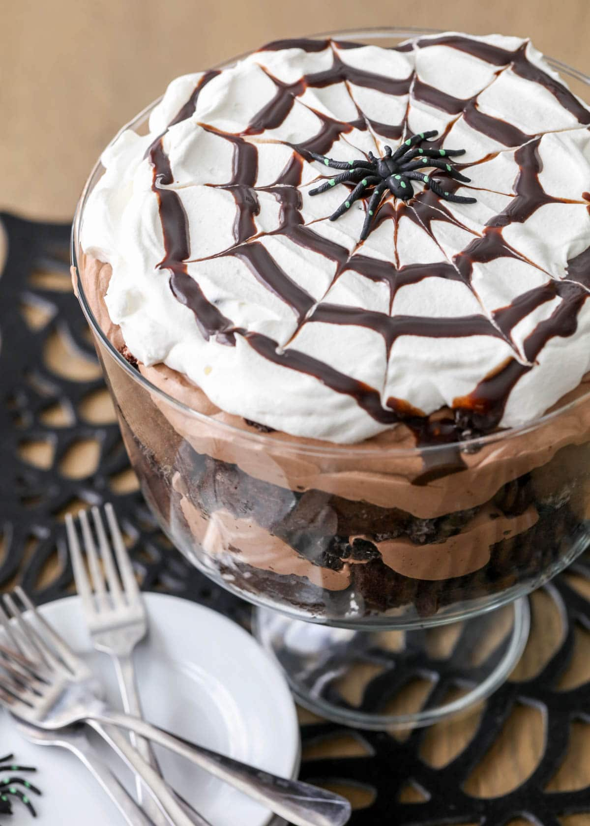 Chocolate spider trifle in a glass dish